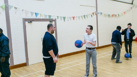 autistic child playing ball