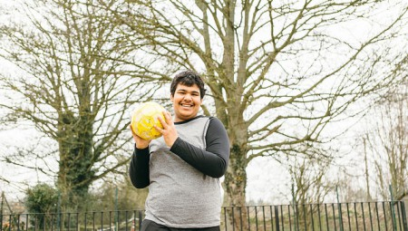 autistic young person playing with ball