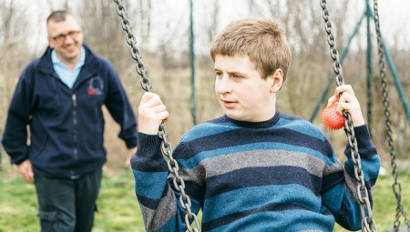 autistic young person on swing